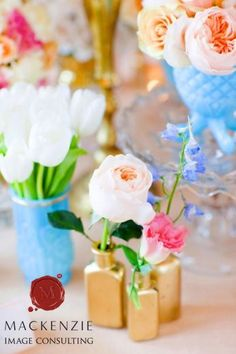Try painting old nail polish bottles and then using them as mini-vases!!