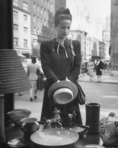 """""""Maeve Brennan of HARPER'S BAZAAR looking through store window."""" Photograph by Nina Leen, 1945. From the Life Photo Archive. """"Manhattan is an island, and so she has two horizons—the architectural horizon, impermanent and stony, and the eternal horizon, constantly changing, that is created when water and sky work together in midair. It may be that the secret of Manhattan's hold over us is lost somewhere between those two horizons, the one hard and vulnerable, the other vague, shifting, and…"""