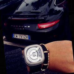 SevenFriday M1 với thiết kế mặt đồng hồ 3D với 12 lớp linh kiện kết hợp cùng vòng tay StingHD bên siêu xe Porsche.