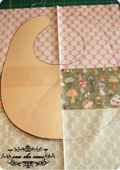 Little tutorial and pattern for a a cute little bib. A great way to use scraps of fabric.