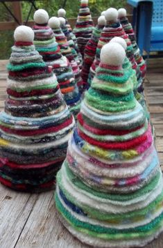 Felted circles, graduated sizes, strung together with wire up the center of the tree.  Cute !