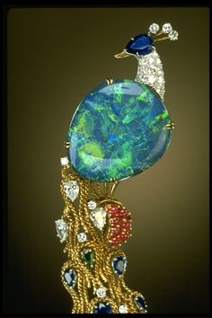 Stunning black opal, diamond, ruby and sapphire brooch, Harry Winston