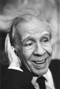 Jorge Luis Borges listening to a shell, Palermo, 1984  Photo: Ferdinando Scianna/ Magnum Photos