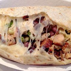 """Chipotle: """"Quesorito""""  The 8 wildest fast food secret menu items  - #1 on the list! It's actually a double secret menu item, because it includes two off-menu items. Three, it's freakin' delicious. It's created by making a traditional quesadilla (a giant tortilla gets filled with cheese then pressed), but after it's been pressed they'll open it up and load it with all the fillings you want. Finally, it's rolled up into the shape of a (giant) burrito."""