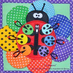 Добрый день! Хочу показать Вам свой новый развивающий кубик, который прекрасно подойдет для занятий с ребенком в игровой форме!! Кубик содержит 45 съемных элементов, все можно потрогать, подергать и, конечно, пофантазировать!)) Далее много фото!