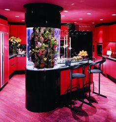 This kitchen is a bit too red for me... However, I love the cylinder aquarium. That is super pretty.