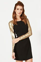 Sequins and Champagne Dress: Black body con dress with gold sequin sleeves. Invisible zipper closure on back.