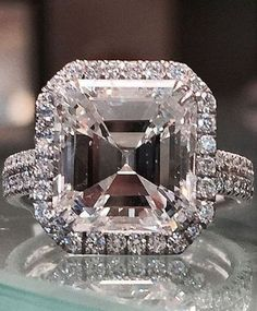 Gorgeous 5.01 asscher cut engagement ring. I see a skull Cool!!
