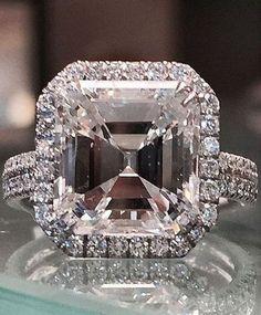 Gorgeous 5.01 asscher cut engagement ring. I see a skull Cool!!