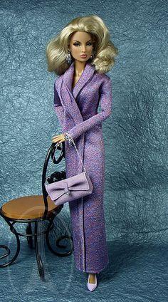 barbie doll in purple dress with purple coat