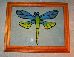 DIY stained glass. Go to the link and you have to click on tutorials n the choices at the top....The example is a peacock, and that is beautiful too. Can make any design you want!