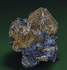 Quartz, Rutile, Hematite Ibitiara, Bahia, Brazil 4.5 x 5.5 cm. thingofinterest- the Rutile(slender needle crystals) formed first then the Quartz crystals formed encapsulating the Rutile.