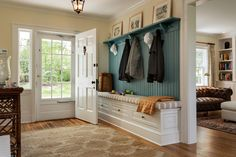 add bench with storage & shelf above with hooks to front entry