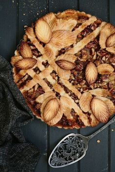 The semi-lattice on this leafy pie crust reminds us of a beautiful garden trellis. Caramel Pear and Pecan Leaf Pie is the best recipe for fall.