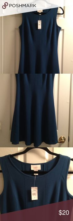 """""""Loft"""" sleeveless """"a-line"""" dress Never worn, cute """"Loft"""" a-line dress. Size 4. The color is a dark teal almost like a hunter greenish blue, thicker fabric that can be worn in winter with a cardigan or blazer. Can also be worn early spring and fall. Length is right at my knee and I'm 5'4"""". Pet free and smoke free home. LOFT Dresses Midi"""