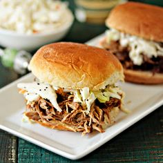 Slow cook the pulled pork, then serve on  hawaiian rolls ** Easy Crockpot Pulled Pork