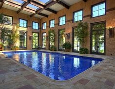 Love it! 20×40-foot Italian glass-tile pool with 18 sets of double glass doors and a summer kitchen. Austin, TX