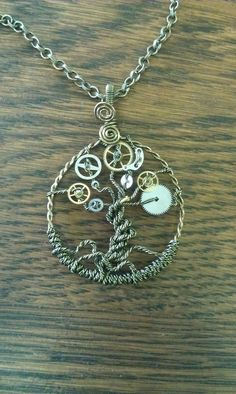 Steampunk Tree of Time Wire Wrapped Necklace with Watch Gears Tree of Life. $29.99, via Etsy.