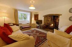 The cosy lounge with woodburner stove | Crannacombe Farm, South Devon | Toad Hall Cottages
