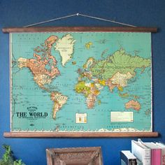 "C. 1930 world map, sized 19.5"" x 28.5"". The wood scroll extends out another inch…"