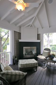 Love this fireplace treatment, with the siding behind it and white accents