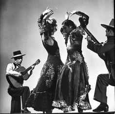 Spanish flamenco dancer Carmen Amaya (R) performing with her sister Antonia. Photograph by Gjon Mili, 1940.