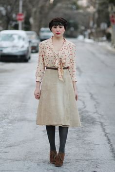 Aline tan skirt, secretary neck tie polka dot blouse, gray tights, braided hair