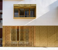 AAVP covers parisian building in golden sheets, carved like iron-worked balconies
