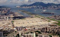 Incredible pictures of airplane near misses show EXACTLY why the world's most dangerous airport in Hong Kong was shut down 15 years ago Kai Tak Airport, Cathay Pacific, 10 Picture, Tv Aerials, 15 Years, Aerial View, Paris Skyline, Hong Kong, City Photo
