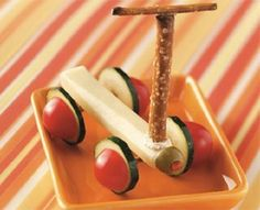 Cheese stick,sliced cucumbers,cherry tomatoes,olive, pretzels sticks held together with cream cheese--cute