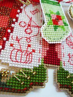 Close up of Kreinik #8 Braid in this Brooke Nolan cross stitch Santa.