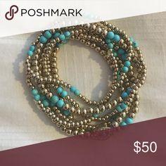 Set of blue and gold beaded bracelets Like new set of 7 blue and gold beaded bracelets. Stretchy. Jewelry Bracelets