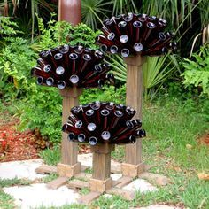 Hey I'm willing to contribute to that art creation.Bottle Tree Art That's A Little Bit Different? Wine Bottle Trees, Wine Bottle Art, Beer Bottles, Blue Bottle, Glass Garden Art, Bottle Garden, Garden Totems, Garden Crafts, Garden Projects