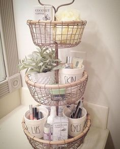 Bathroom organization Rae Dunn planters with Rae Dunn inspired decals tiered tray farmhouse bathroom makeup organizer