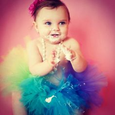 love the rainbow tutu....make something that comes up over her chest with a bow on her chest into a halter??