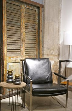 Modern Leather chair with steel frame. Wood & metal side table. Vintage Teak doors.