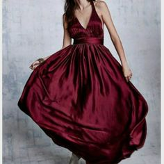 Free People x Rae Francis burgundy FALLON DRESS Slightly shimmery Grecian inspired gown with banded empire waist, featuring elegant soft pleating along seams. Silk belt included. V-Neckline with statement braided straps and T-Back. Fully lined. Hidden side zip closure. American made.   *By rae|francis    *100% Polyester  *Dry Clean  *Made in the USA    Approximate Measurements for 10: Waist: 30? Length: 66? Free People Dresses