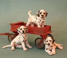 Three 1:12 dolls house scale dalmation puppies in a wagon by Kerri Pajutee. - Photo Courtesy Kerri Pajutee  Copyright 2008 Used With Permission