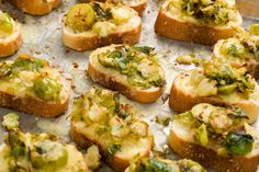"""Shredded Brussels sprouts sautéed in a mixture of garlic and crushed red pepper, then topped on toasts with white cheddar will leave you saying """"Insane!"""" in the best way. Get the recipe from Delish.   - Delish.com"""