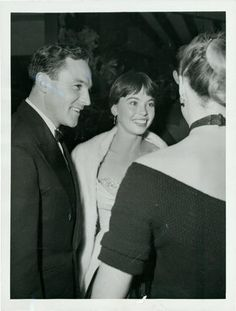 Gene Kelly and Leslie Caron at a Hollywood party in 1953.