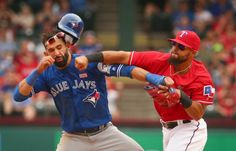 Rangers second baseman Rougned Odor punches Toronto's Jose Bautista