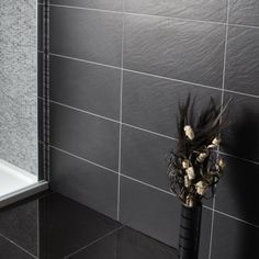 Ardeisa Nero tiles, £25.95 per pack of 7 tiles (30.5x61cm each), Better Bathrooms