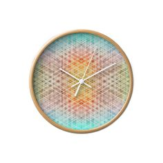 Liven any uninspired wall space with this wonderful timepiece. The Intricacies Wall Clock bears a gorgeous multicolor geometric design on its face, and features sleek white clock hands and elegant natu...  Find the Intricacies Wall Clock, as seen in the Tulum's Casa Xixim Collection at http://dotandbo.com/collections/tulums-casa-xixim?utm_source=pinterest&utm_medium=organic&db_sku=109409