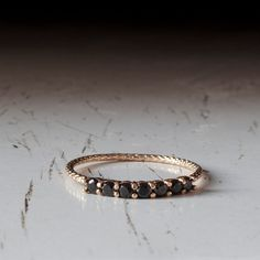 9 Karat Gold Onyx Ring Set with an Exquisite lines of 7 Black onyx in an handmade 7 stone Ring. Lovely Everyday ring with Presence, Elegance and sheer beauty. Excellent affordable everyday ring with high quality gemstones! All ring sizes available. Great for Stacking rings also - check out the stacking picture! (last picture)