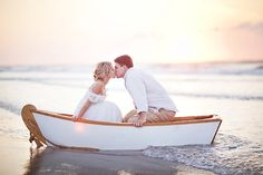 Beach Themed Wedding - Bride & Groom in a boat for two.