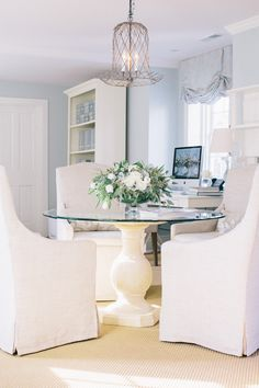 wedding planner office idea - blue room and white slip covered dining chairs