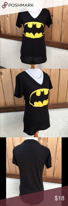 """Womens Fitted V Neck Batman T-shirt Womens V Neck fitted Batman t-shirt has short sleeves. Dark black and a bright yellow Batman symbol. Worn once to a theme party. 50% Cotton & 50% Polyester. Measures 16.5"""" pit to pit and 26.5"""" from shoulder seam to bottom of shirt. Excellent like new condition. NO spots or damage. DC Tops Tees - Short Sleeve"""