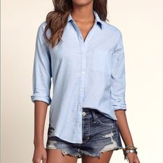Large blue button-up Large blue button-up shirt from Hollister. As with most things from Hollister, runs a little on the small side. Still in perfect condition! No holes or stains! Model is not wearing exact same style or color of shirt! Hollister Tops Button Down Shirts
