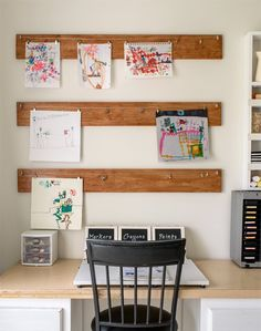 How cute is this DIY kid's art organizer? You can change out your little artists creations easily and you'll also free up your refrigerator doors.