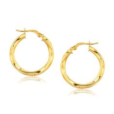 14K Yellow Gold Classic Twist Hoop Earrings (7-8 inch Diameter) These classic twist hoop earrings are crafted in 14K yellow gold and measure 7/8 inch diameter, featuring a hinged snap locking.<br><br><b>Metal Name: </b>Yellow Gold<br><b>Metal Content: </b>14K<br><b>Width: </b>0.12 in<br><b>Length: </b>0.78 in<br><b>Backing: </b>Hinged Snap Back<br><b>Diameter: </b>0.78 in<br>